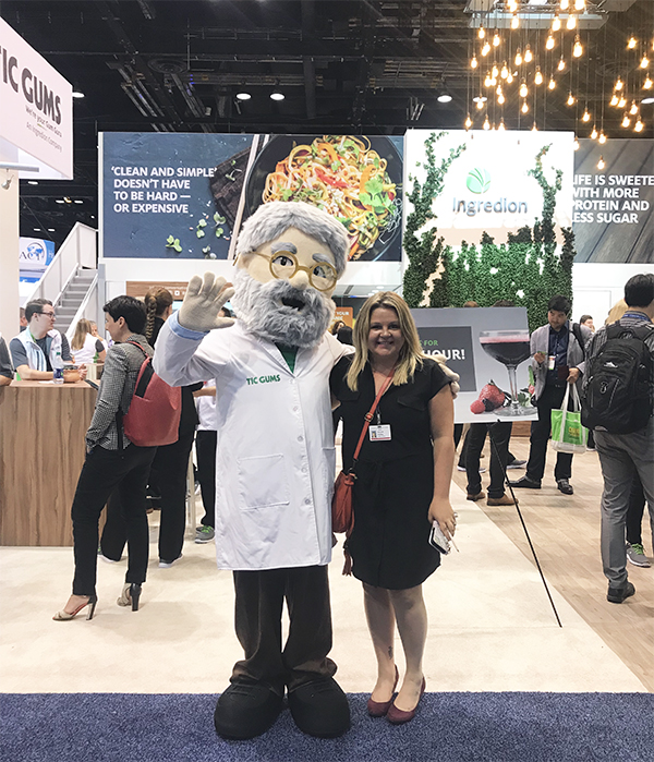 Miranda with trade show booth mascot